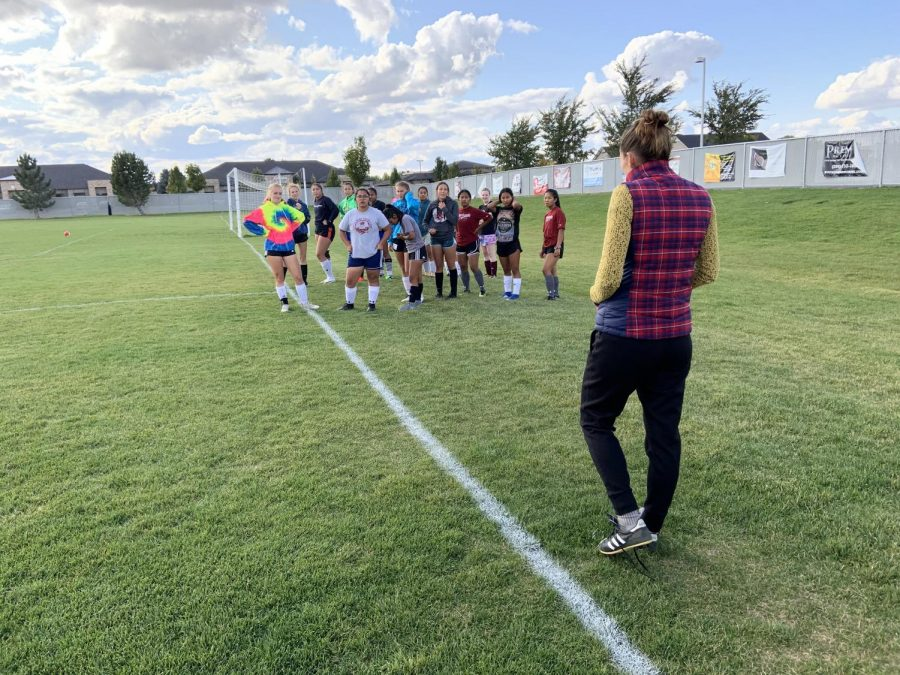 Coach Cristina Tacket gets here soccer players ready for practice on October 3, 2019