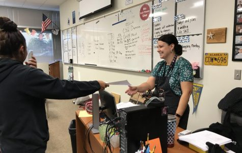 Mrs. Franklin happily works with a student to keep her from becoming a failing student.
