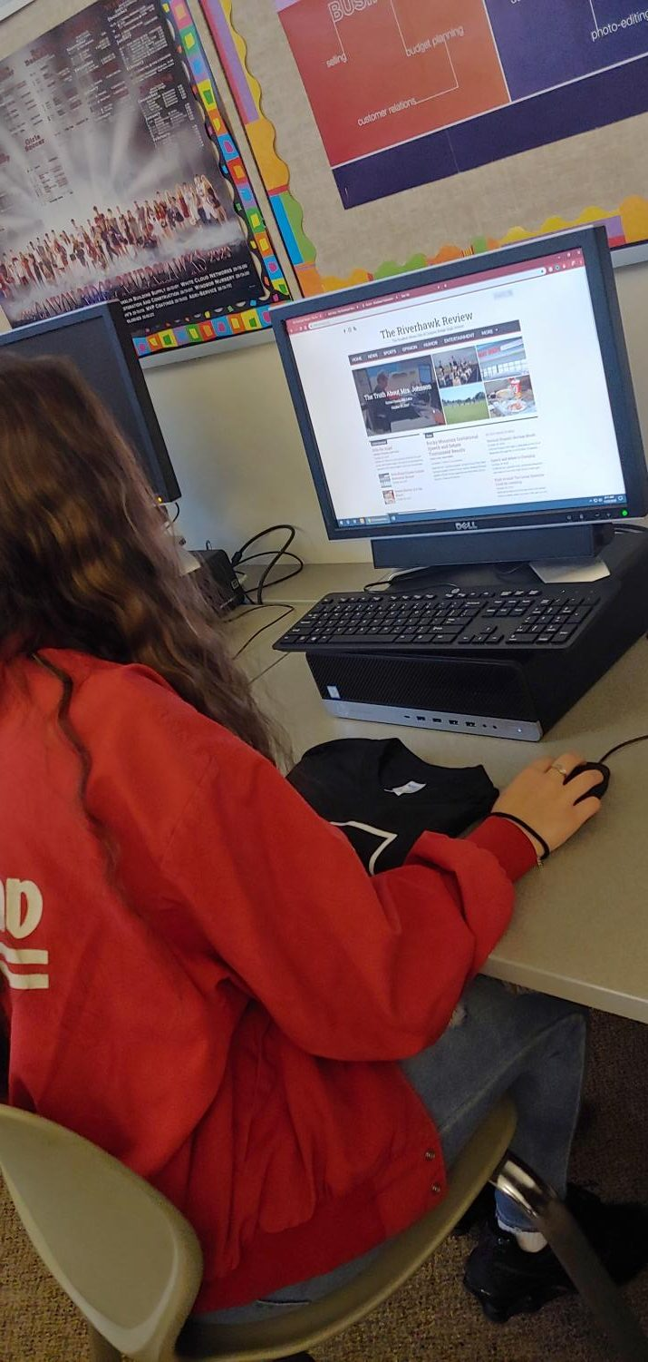 Yzabella Eggers working on this website during her 1st period Publications, to upload articles for you all to read