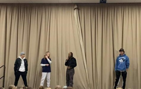 Kylie Bronk, Taylor Hatala, Comfort Fedoke, and Jason Celaya standing on stage introducing themselves to everyone at the convention