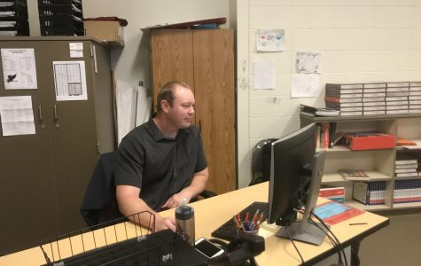 Coach Sundiquist working on his computer at his desk